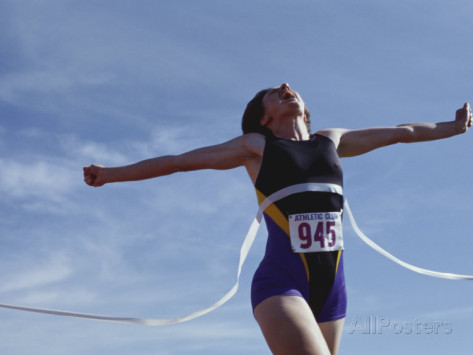 female-runner-victorious-at-the-finish-line-in-a-track-race