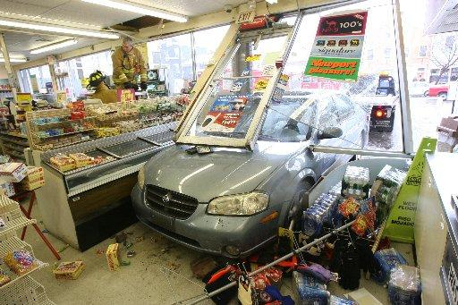 car-crashes-into-storefront.jpg