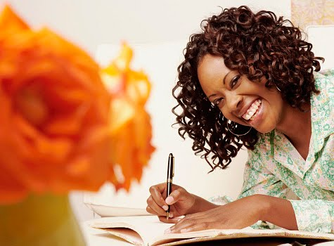 black-girl-smiling-writing