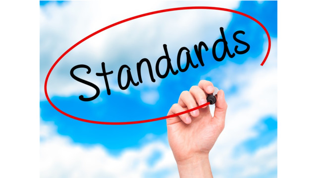 bigstock_man_hand_writing_standards_wit_118862333-56fc2a72130ba